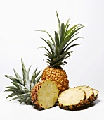 Whole and sliced pineapples