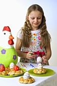 Girl decorating Easter eggs