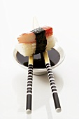 Nigiri sushi with soy sauce and chopsticks