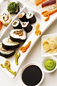 Sushi platter with soy sauce, wasabi paste & pickled ginger