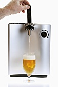Pouring a glass of draught beer