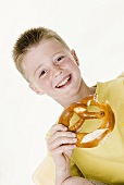 Boy holding a bitten pretzel in his hand
