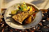 Grilled swordfish steak with vegetables