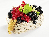 White, black and redcurrants in basket
