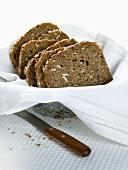 Sliced wholegrain bread in a bread basket