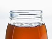 An open jar of honey