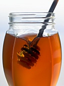 Honey dipper in a jar of honey