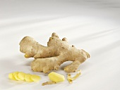 Ginger root with a piece and slices of ginger