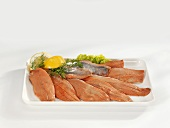 Smoked matjes herring fillets on a platter