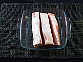 Slices of pork in a heat-resistant glass dish