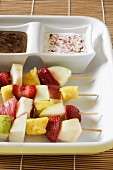 Fruit kebabs with chocolate dip and yoghurt dip