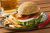 Hamburger with chips and beer