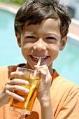 Boy drinking a glass of iced tea