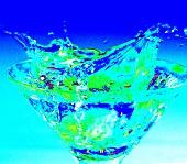 Martini splashing out of a Martini glass