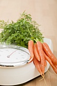 Carrots on bathroom scales