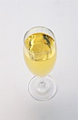 A glass of sparkling wine in a champagne flute
