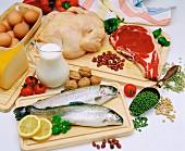 Various foodstuffs on wooden board