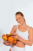 Smiling woman with basket of fruit