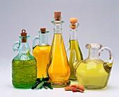 Various types of oil in oil bottles