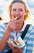 Blonde woman eating chips