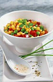 A bowl of sweetcorn, peas and diced peppers