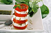 Tomato and mozzarella tower with basil and pesto