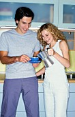 Couple in kitchen drinking coffee