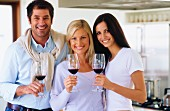 Man and women with glasses of red wine