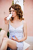 Woman in dress drinking milk from plastic bottle