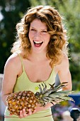 Laughing woman with pineapple