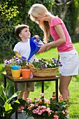 Mother and son watering plants