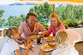 Family eating lunch on seaside holiday