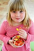 Girl eating fruit gums