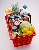 Assorted foodstuffs from the supermarket in a shopping basket