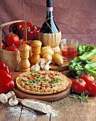 Vegetable pizza with ingredients and a bottle of wine