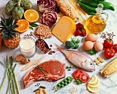 A still life featuring assorted basic foodstuffs