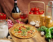 Vegetable pizza, fresh from the oven, with ingredients and a glass of wine