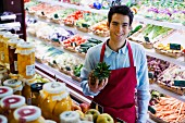 Sales assistant in supermarket with pineapple