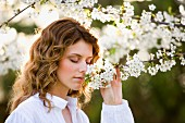 Woman smelling fragrant blossom