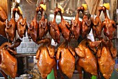 Chickens and ducks hanging up in a Chinese shop