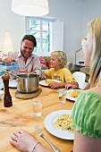 Family eating spaghetti for dinner
