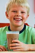 Boy with a chocolate milkshake