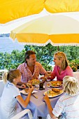 Family eating a meal on holiday