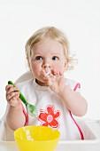 Little girl eating mush