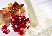 Milk and fresh pomegranate seeds