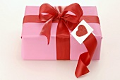 Gift with red bow and heart