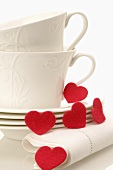 Coffee cups and red hearts