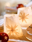 Tealights in paper bags (Christmas table decoration)