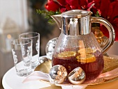 Punch with orange slices in glass jug (Christmas)