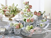 Romantic table with roses and lisianthus